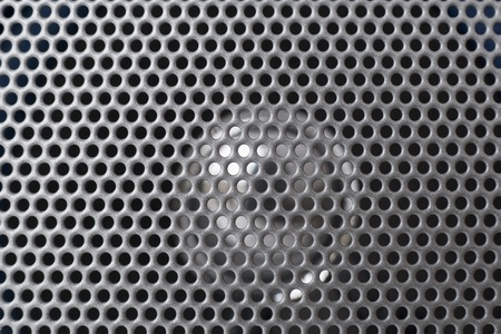 Spherical silver speaker grid  grille background texture macro. Selective focus Stock Photo - 12996489