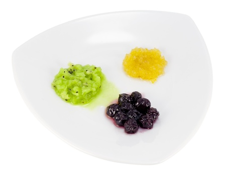 Minimalism in food concept- jam, mashed kiwi fruit and cherries in white plate  Isolated with patch Stock Photo - 12995185