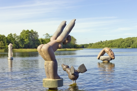 the bather: Bather,Wwild Duck, Despair. Public domain Sculptures of granite in the cold lake water.