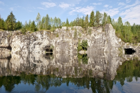 Summer Landscape - old river, marble beaches, wild  Siberian taiga forest grows on rocks, blue sky  Art soft  selective focus photo