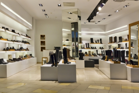 shoe store: Shoe standart mass production  shop - evening lighting, isnt present buyers