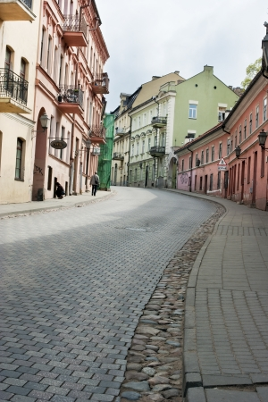 public domain: Narrow cobblestone road street in the old public domain European city