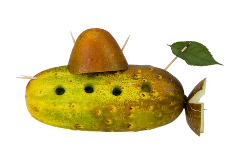 We all live in a yellow submarine concept. Collage from old cucumbers and toothpicks. Isolated Stock Photo - 24039486