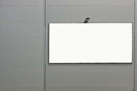 emty: Steel gray corrugated wall of a supermarket with advertizing. Emty area isolated with patch