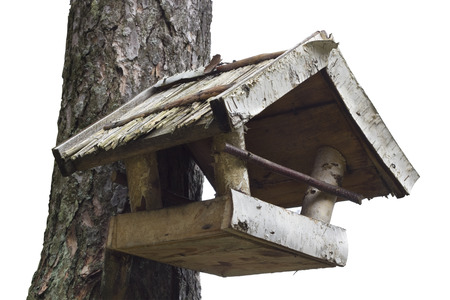 feeders: Birds feeders made of birch boards. Isolated with patch. Selective focus Stock Photo