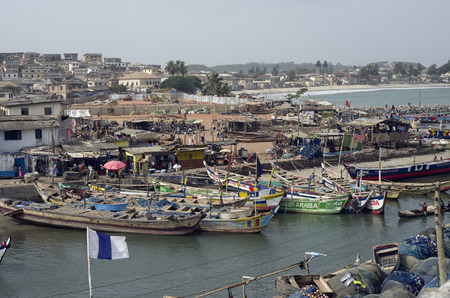 colonization: ACCARA, GHANA - FEBRUARY, 2014: Fishing boats in rural fishing village near the capital of the republic Ghana in February 22, 2014. In 1957, Ghana became the first African nation to declare independence from European colonization. Editorial