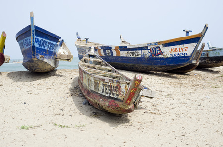 declare: ACCARA, GHANA - FEBRUARY, 2014: Old broken fishing boats on the African sea coast  of the republic Ghana in February 22, 2014. In 1957, Ghana became the first African nation to declare independence from European colonization.