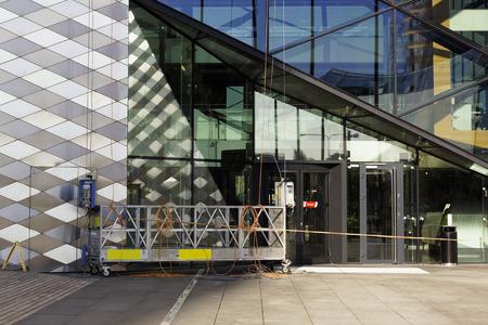 Windows washing platform ready for use on glass  skyscraper