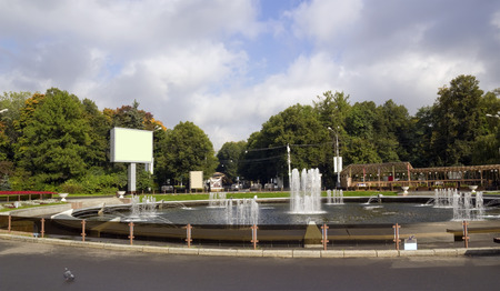 public domain: Empty mass production biilboards stand in autumn Moscow city public domain  park. Sunny day. WIth empy areas patches Stock Photo