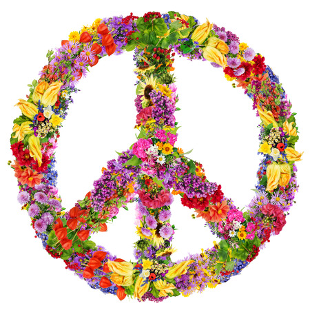 Peace symbol abstract collage made from fresh summer flowers. Isolated