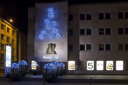 christmas perfume: VILNIUS, LITHUANIA - DECEMBER 24: Christmas night and advertising  perfume Chanel 5 in Vilnius on December 24, 2013. Chanel brand  owns 147 boutiques around the world. Chanel annual turnover of about $ 1.089 billion