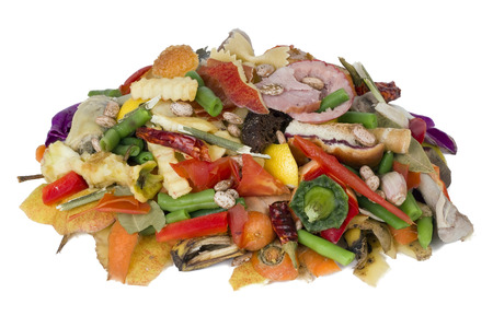 On a white table lies a heap of rotten food waste closeup concept Archivio Fotografico