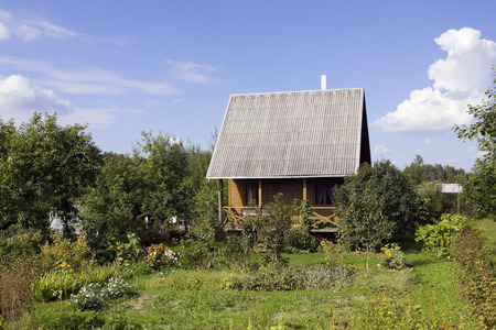 impoverished: Abandoned residential home and garden in the impoverished European village concept. Sunny day Editorial