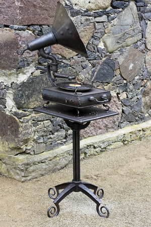 18th century: Retro old  rusty music gramophone from the 18th century in raindrops outdoor concept.