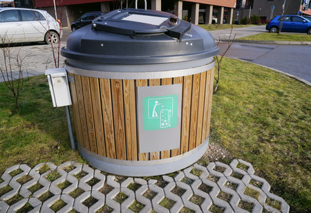 locked in: Modern locked green ecological trash bin in the new residential city area Editorial