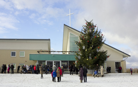 christmas prayer: VILNIUS, LITHUANIA - DECEMBER 25, 2014: People came to a day Christmas prayer to Saint Josefs church, which was founded  in 1999. The sermon goes in the Lithuanian and Polish languages. Editorial