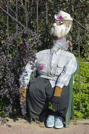 effigy: The handmade  naive effigy - dummy is dressed in clothes of the peasant and protects a kitchen garden from crows Stock Photo
