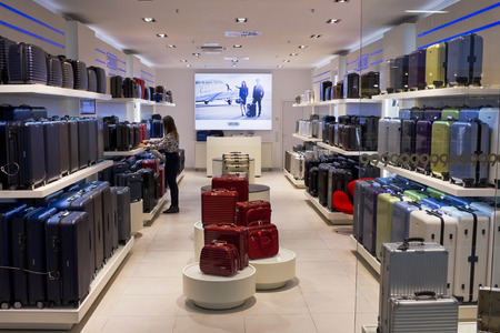 elite: VILNIUS, LITHUANIA - NOVEMBER 29, 2014: Boutique of elite suitcases and cases of Rimowa  brand. Release of magnificent lungs and strong aluminum suitcases began in 1937.