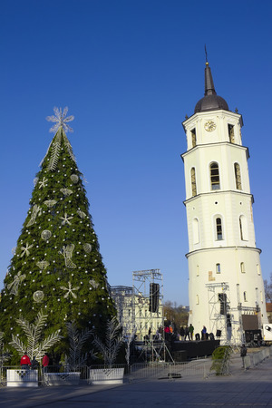 ceremonial: VILNIUS, LITHUANIA - NOVEMBER 29, 2014: Decoration  of the Christmas fir-tree on a main square of the city for a ceremonial opening of New Years actions. Frosty sunny day