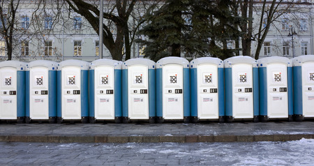 leases: VILNIUS, LITHUANIA - NOVEMBER 29, 2014: Bio toilets on a main square. The city is ready to celebrate Christmas. Toi Toi  brand leases streets bio toilets in 33 countries of the world.