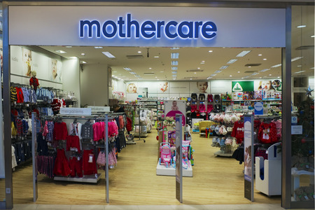 mothercare: VILNIUS, LITHUANIA - DECEMBER 13, 2014: Mothercare store in xmas Panorama  market. Company was founded in London in 1961. Brand have over 1100 stores worldwide. Editorial