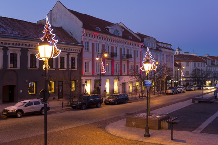 laterns: VILNIUS, LITHUANIA - DECEMBER 26, 2014:  Christmas laterns and illumination on streets of the old city. In 2015 Lithuania passes to the European currency Editorial