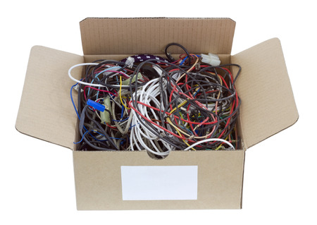 utilization: The heap of old copper wires in a cardboard box is prepared for utilization. Isolated with patch