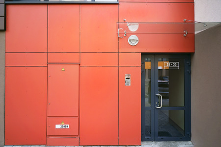 metall and glass: Panorama of a red entrance to an elite mass production penthouse