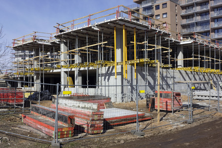 inhabited: Beginning of conctruction of an mass production inhabited apartment house in sunny spring day Stock Photo