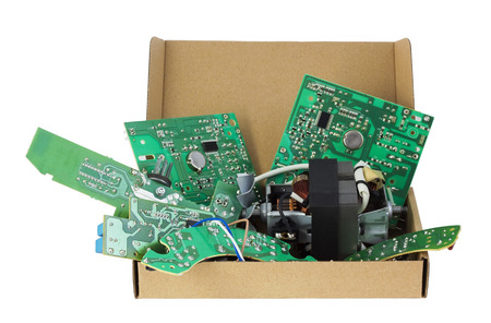cardboard only: Old electronic printed-circuit boards are prepared for utilization. Standard cardboard packing. Only position designations of elements. Isolated with patch
