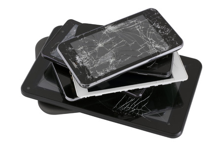 Heap of modern electronic gadgets with the broken screens. Devices are prepared for utilization. Isolated with patch Standard-Bild