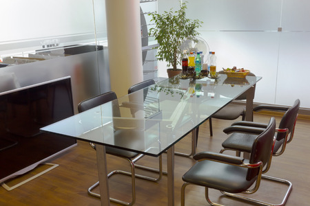 Meeting  unch break in a small conference hall with glass walls and a table concept photo
