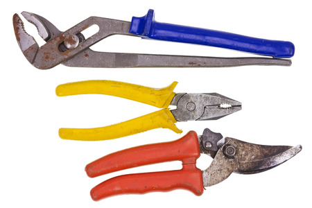 The old rusty used tools set. Flat-nose pliers secateurs and adjustable spanner. Isolated on white photo