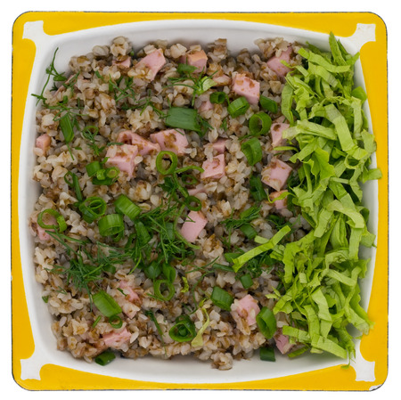 high calorie: Simple high calorie tasty fat  rural food. Buckwheat cereal porridge with ham sausage  and a green salad. Isolated. Top view shot Stock Photo