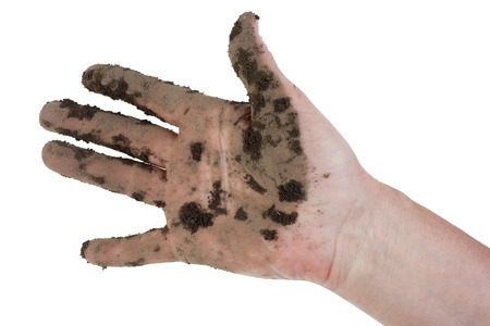 laborer: Hand of the working farm laborer it is soiled by dirt and manure. Isolated poverty concept Stock Photo