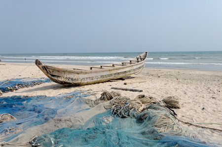 colonization: ACCARA, GHANA - JANUARY 18, 2014: Fishing poor boat and nets on sea sand coast in rural fishing village.  In 1957, Ghana became the first African nation to declare independence from European colonization. Editorial