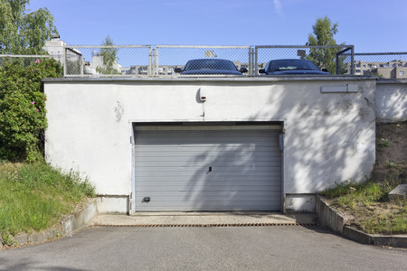 no name: Gates  in no  name underground automobile garages and a parking in the  standard design residential European city area. Sunny August  day landscape
