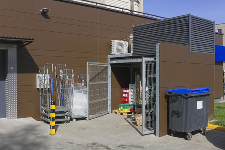 utilization: Correct modern utilization and collecting garbage for city shop landscape. Containers, steel gate and conditioners