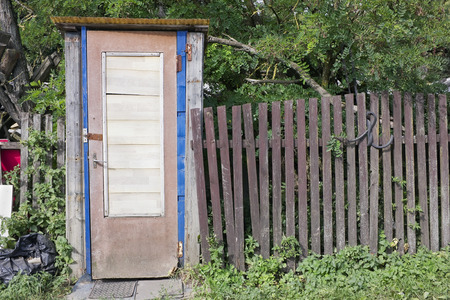 latrine: Handmade  rural wooden  toilet  latrine in a summer european garden. Sunny day landscape