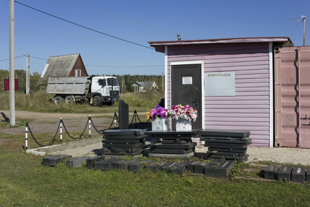 openly: KUBINKA, RUSSIA - SEPTEMBER 21, 2015: Sale of flowers and granite monuments near a rural cemetery. Information in Russian - openly round the clock. In a year in Russia 2,5 million people die