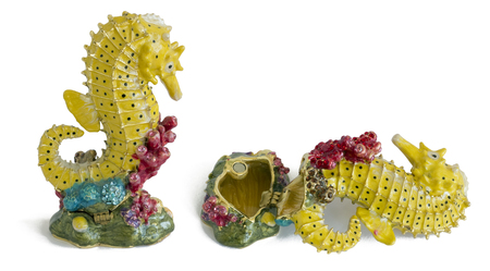 mass storage: MOSCOW, RUSSIA - SEPTEMBER 18, 2015:  Mass production of the Chinese  industry. A fish sea horse - metal  box for jewelry. Symbol of success and wealth. Illegal copy of a known brand