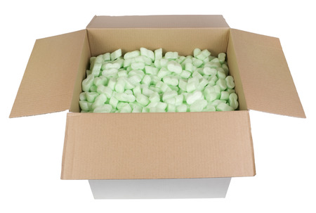 foam safe: The big white cardboard box is filled with green bubbly plastic protective granules. Isolated with patch
