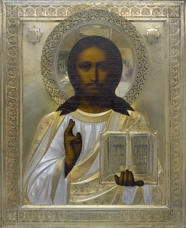believing: MOSCOW, RUSSIA - SEPTEMBER 18, 2015: Standard orthodox icon with the image Jesus Christ in a metal bronze frame. Thousands of similar icons hang in churches and houses of the believing people