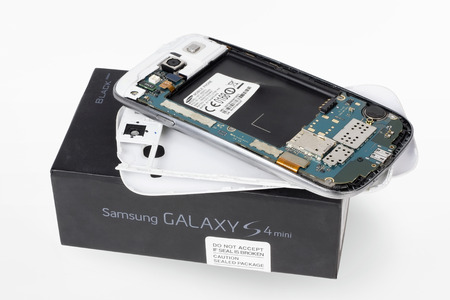 samsung: VILNIUS, LITHUANIA - DECEMBER 23, 2015:  Broken disassemble Samsung Galaxy brand smart phone in repair service centre. In 2014 Samsung sold more than 80 million phones