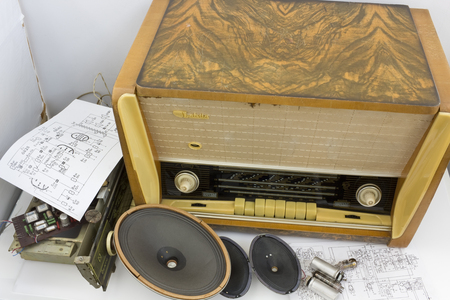 ebonite: VILNIUS, LITHUANIA - DECEMBER 15, 2015: Vintage retro tube radio receiver from 1959 handmade repair. An antique radio is a radio receiving set that is collectible because of its age and rarity.