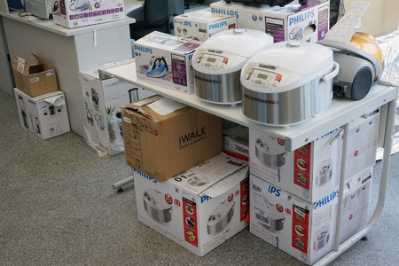 philips: VILNIUS, LITHUANIA - JULY 03, 2015: Working room of small service center for repair of Philips brand  home  electronics. Philips is the largest global manufacturer of household appliances