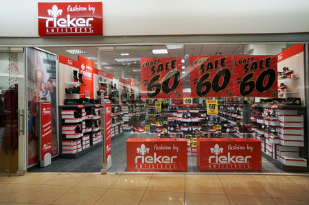 bad times: VILNIUS, LITHUANIA - JANUARY 09, 2016: Bad times for footwear shoe Rieker antistress.  Discounts to 60 percent dont attract buyers in Europe. Empty deserted shop - it is reality of our time