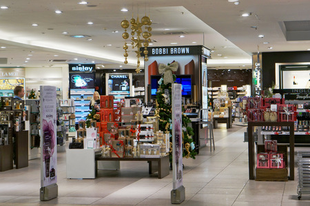 christmas perfume: VILNIUS, LITHUANIA - DECEMBER 19, 2015: Xmas  Bobbi Brown  cosmetic shop in  Panorama market. In 1991. the ten shades debuted under the name Bobbi Brown Essentials