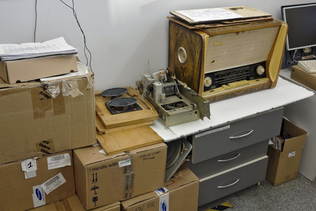 ebonite: VILNIUS, LITHUANIA - DECEMBER 16, 2015: Vintage retro tube radio receiver  repair in modern small service center. An antique radio is a radio receiving set that is collectible because of its age and rarity. Editorial