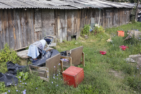 sheds: The Gipsy slums and sheds in the urban residential city area Pilaite.  In any European country Roma dont want to observe universal laws Stock Photo